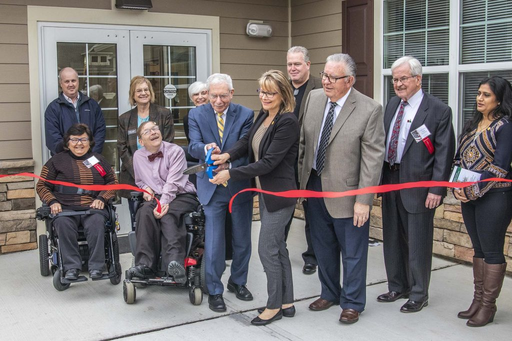 NJHMFA Executive Director Charles A. Richman (center) helps cut the ribbon at Freedom Village at West Windsor on March 3, 2020, joined by Project Freedom Inc. Founder Norman Smith (to Richman's left), Supportive Housing Association of New Jersey Executive Director Diane Riley (behind Richman). Also pictured, West Windsor Council President Virginia Manzari; Project Freedom Executive Director Timothy Doherty and Project Freedom board of trustees Chairman C. Herbert Schneider.
