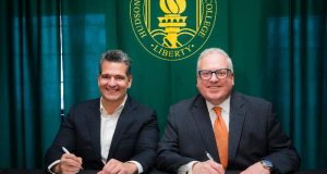 Statewide Hispanic Chamber of Commerce of New Jersey President Carlos Medina, left, and Hudson County Community College President Chris Reber formalize an agreeemtn between the entities on March 3, 2020. - HUDSON COUNTY COMMUNITY COLLEGE