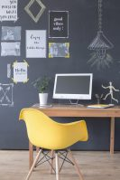 Cropped shot of an office interior with a minimalistic wooden desk and yellow chair