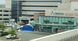Workers remove the triage tent that was positioned outside the Trinitas ER since early March. -TRINITAS REGIONAL MEDICAL CENTER