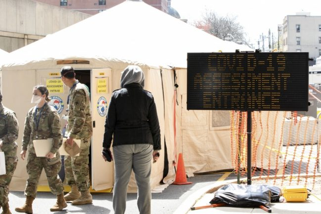 Soldiers with the U.S. Army's Urban Augmentation Medical Task Force 332-1, 332nd Medical Brigade out of Nashville, pass through the COVID-19 assessment entrance at University Hospital on April 14, 2020, during orientation at the hospital.