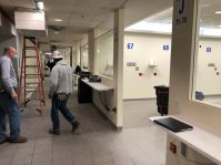 Crews work to tranform the cafeteria at HUMC into an ICU treatment area for COVID-19 patients.