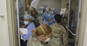 Soldiers from the U.S. Army's Urban Augmentation Medical Task Force 332-1, 332nd Medical Brigade, Nashville, Tenn., get their masks fitted during orientation at University Hospital on April 14, 2020.
