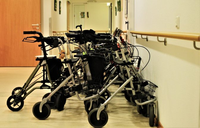 A line of walkers in a hallway.