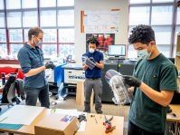 Volunteer construct face shields at Montclair State University's MIX Lab. - MIX LAB