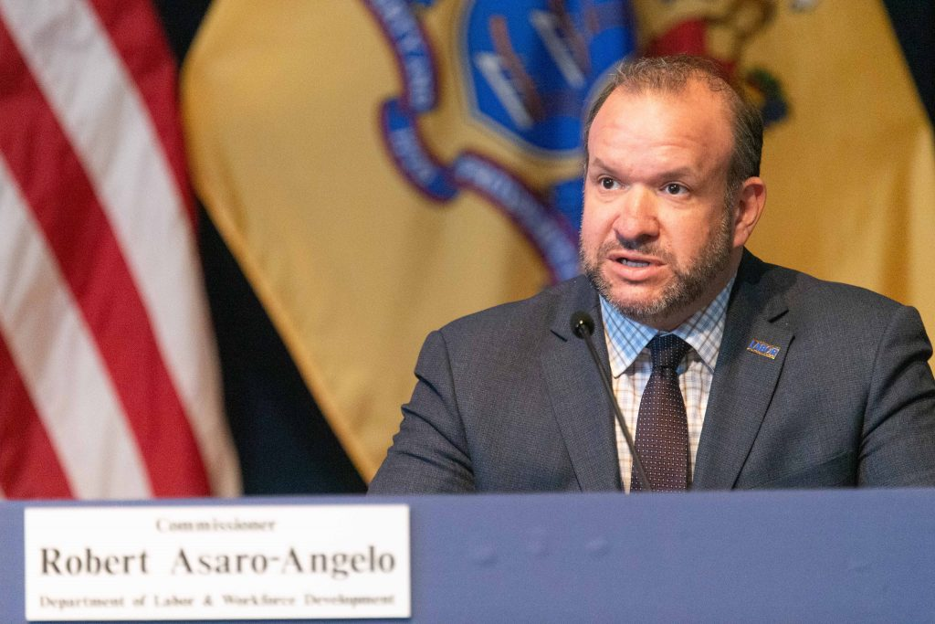 Commissioner of the New Jersey Department of Labor Robert Asaro-Angelo joins Gov. Phil Murphy at his daily COVID-19 press briefing in Trenton on May 7, 2020.