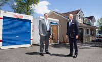 From left, Harrison and Peter Till rented two storage units for the Jewish Family Service of Central New Jersey's food patnry to ensure it can keep up with increasing demand. -KEITH MUCCILLI