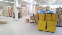 Boxes of PPE stacked in what was once a conference area in Bayada's office building. - BAYADA