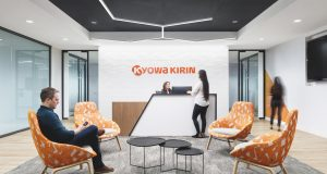 HLW designed Kyowa Kirin's new Bridgewater office space with its signature color scheme of white, gray, black, and orange.