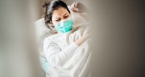 Sick woman with mask in mobile quarantine hospital units isolation.Coronavirus Covid-19 patient having pneumonia disease symptoms health care treatment.Painful cough.Lung disease.Antitussic drug help