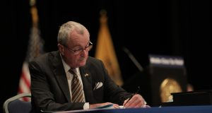 Gov. Phil Murphy signs the Fiscal Year 2021 Budget at the Trenton War Memorial on Sept. 29, 2020.