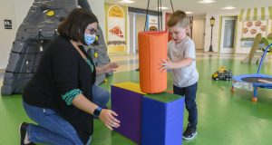 A NeurAbilities therapist interacts with a child at one of the organization's new autism treatment centers in Pennsylvania. Similar facilities are coming to Freehold and Cherry Hill, this fall.