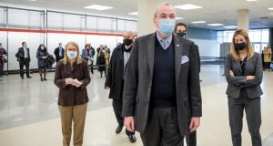 "Governor Phil Murphy arrives to tour the opening of the Morris County vaccination site, one of New Jersey's planned six vaccine ""mega-sites"" - at Rockaway Townsquare Mall in 2021."