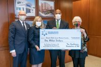 The Healthcare Foundation of New Jersey presents the first installment of its $5 million commitment to Newark Beth Israel on April 16, 2021. From left, RWJBarnabas Health Executive Vice President and Chief Development Officer Glenn Miller, Healthcare Foundation of New Jersey Board Chair Amy Schechner, Newark Beth Israel Medical Center and Children's Hospital of New Jersey President and CEO Darrell Terry Sr., and Healthcare Foundation of New Jersey Executive Direcotr and CEO Marsha Atkind. - RWJBARNABAS HEALTH