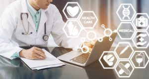 Medical Concept - Doctor working in hospital with computer and writing paperwork illustrated with medical icons pop up from doctors hand about healthcare pharmacy business and doctoral education.