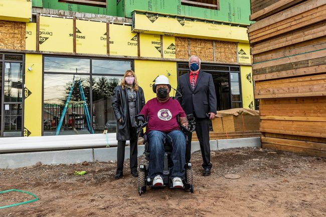 Eric LeGrand at the future site of his Coffee House with Woodbridge Mayor John McCormac and Redevelopment Agency Executive Director Caroline Ehrlich. -JEFFREY AUGER