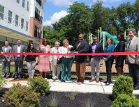 On June 15, 2021, Volunteers of America Delaware Valley (VOADV) joined local elected officials and community partners to celebrate the opening of Centerton Village, the organization's newest affordable housing community in Mount Laurel. VOADV President and CEO Dan Lombardo (fifth from left) and COO Kathy White (fourth from left) joined Mount Laurel Township Mayor Stephen Steglik (fourth from right) and Councilwoman Karen Cohen (third from right), Assemblywoman Carol Murphy and Assemblyman Herb Conaway (both center), TD Bank's Robert Curley (second from left), Burlington County Commissioner Daniel O'Connell (far right) and more in marking the occasion.