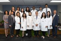 Internal Medicine residents participate in the Community Medical Center's first Long Coat Ceremony on July 7, 2021. Now a teaching hospital, CMC recently launched a graduate medical education program to help educate the next generation of physicians. - COMMUNITY MEDICAL CENTER