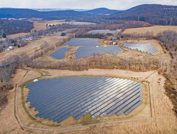 The 8-megawatt Milford Solar Project was the first clean power plant constructed on the abandoned mill site in Milford. - PRNEWSWIRE
