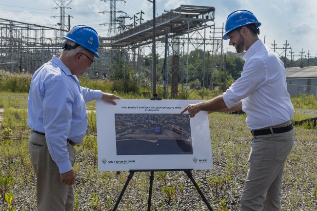 From left, South Amboy Mayor Fred Henry and Rise Light & Power CEO Clint Plummer review future plans to transform the former coal-fired Werner Generating Station in South Amboy into a clean energy hub, the Outerbridge Renewable Connector.