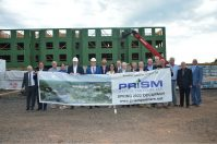 Members of Prism Capital Partners' development team, Dunellen Borough officials and other stakeholders celebrate the frame-out of Dunellen Station's first building on Sept. 30, 2021.