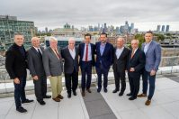 From left, KRE Group Design Director Marc Kushner, I.B.E.W Local Union 164 Business Manager Dan Gumble, Hudson County Executive Thomas DeGise, Hudson County Building Trades President Patrick Kellerher, Jersey City Mayor Steven Fulop, KRE Group President Jonathan Kushner, National Real Estate Advisors President and CEO Jefferey Kane, KRE Group Chairman Murray Kushner, and KRE Group COO Jeremy Kaplan celebrate the lease-up of Journal Squared's Tower 2, and break grown on the projects third tower, on Oct. 5, 2021. - CAHN PR